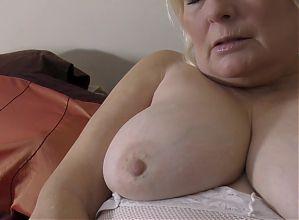 Busty granny feeding her old cunt